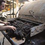 Feeding Zwartbles Wool into Teasing Machine