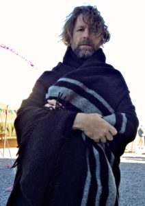 Liam Ó Maonlaí wrapped in his Zwartble Travel Rug