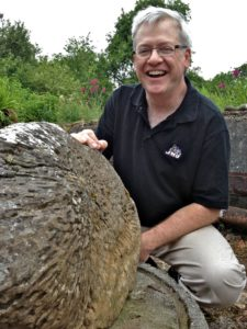 John Haynes with Fossilised Coral Roots