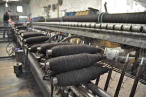 Zwartbles Yarn on Bobbins being Changed on the Spinning Mule