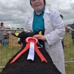 Alicia O'Keeffe with Her Red Ribboned Ram Angus