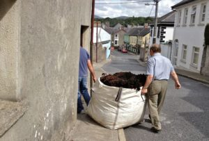 Jim & Philip Bringing a Bag into Storage Shed