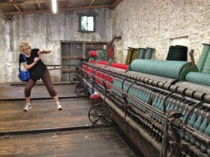 Rosamond Taking a photograph of the Wonderful Spinning Machine