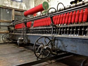 Cushendale Woollen Mills Spinning Machine Dressed in Red