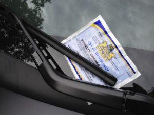 Sleek Posh Cars Get Parking Tickets